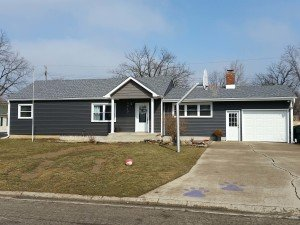 new roof on blue house installed by clemens home solutions
